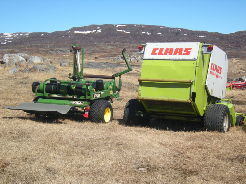 Ipiutaq guest farm, round baler and bale wrapper